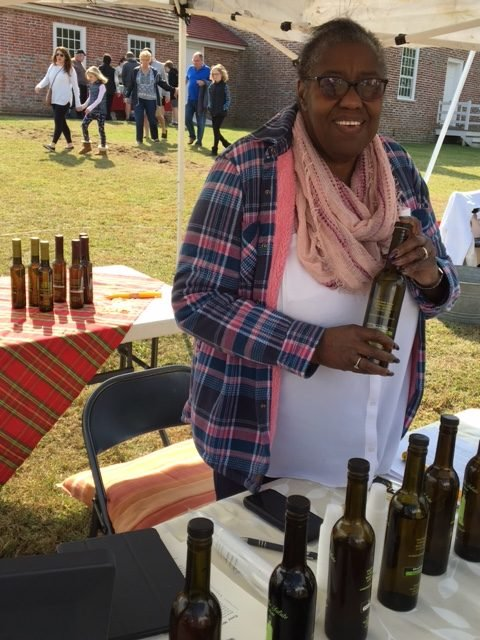 woman selling olive oil
