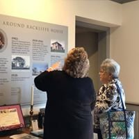 two women reading a display
