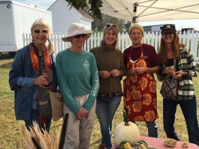 women at the colonial fair